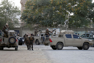 Afghan security forces arrive at the site of a blast in Kabul, Afghanistan