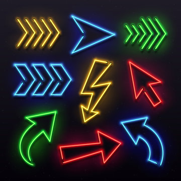 Realistic neon arrows. Night arrow sign lamp lights. Shining arrowhead signs and glowing directional pointers vector set
