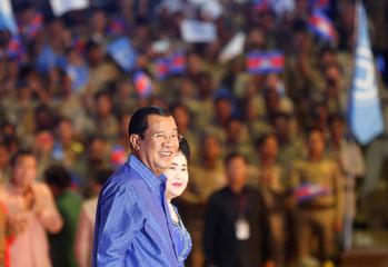 Cambodia's PM Hun Sen and his wife Bun Rany smile during UNESCO anniversary in Phnom Penh
