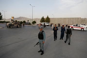 Afghan policemen arrive near the site of a blast in Kabul