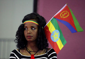 Woman wears the Ethiopian and Eritrean national flags during a concert in Addis Ababa