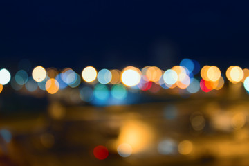 Defocused background of a cityscape at night. Abstract background with bokeh and lights