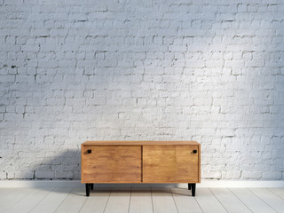 vintage wooden commode at brick wall