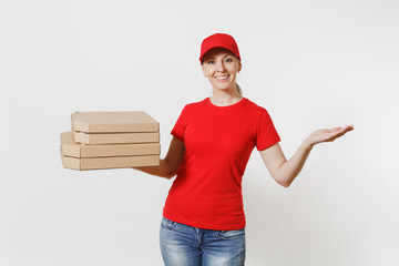 Woman in red cap, t-shirt giving food order pizza boxes isolated on white background. Female pizzaman working as courier or dealer holding italian pizza in cardboard flatbox. Delivery service concept.