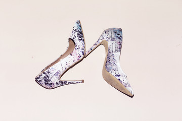 floral pump hight heeled on pink background
