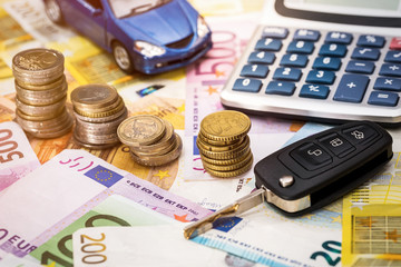 The machine, keys, coins and calculator are on euro banknotes