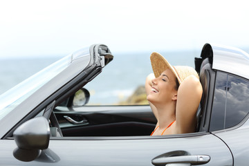 Relaxed driver resting inside a convertible car