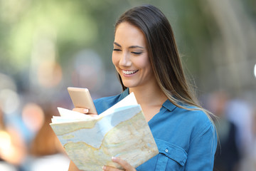 Tourist checking destination in a smart phone and map