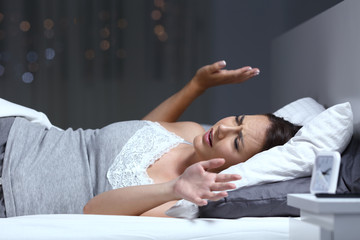 Woman having a nightmare in the night