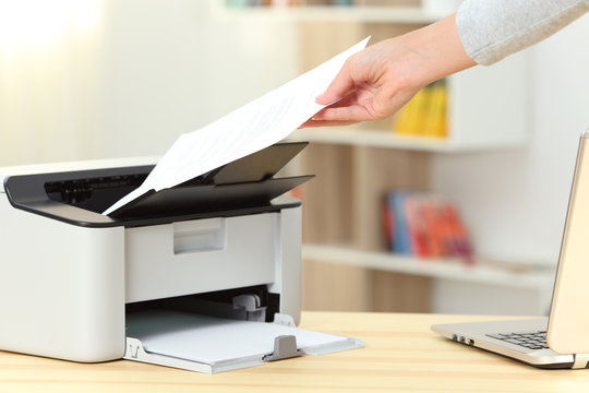 Woman hand catching a document from a printer