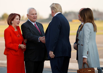 U.S. President Donald Trump and first lady Melania Trump are greeted by Ambassador Robert Frank Pence, Ambassador of the United States of America to the Republic of Finland and his wife Mrs. Suzy Pence, at Helsinki-Vantaa airport in Vantaa