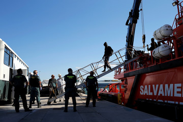 Migrant disembarks from a rescue boat after arriving at the port of Algeciras
