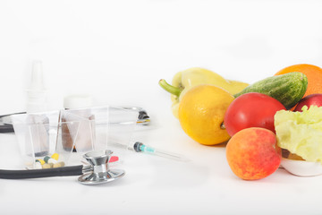 Healthy organic fruit and vegetable for proper nutrition and diet. Choice between drugs and healthy eating.