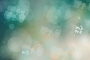 Abstract green bright bokeh background with green and white circles.