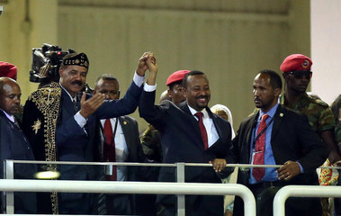 Eritrea's President Isaias Afwerki and Ethiopian PM Abiy Ahmed hold hands in Addis Ababa