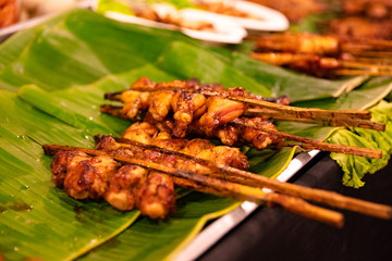Chicken Satay Served On Banana Leaves At Street Market