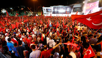 People attend a ceremony marking the second anniversary of the attempted coup at the Bosphorus Bridge in Istanbul