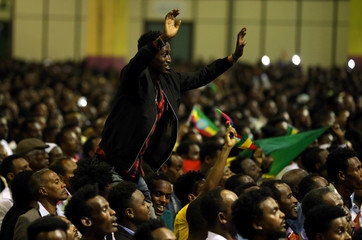Resident cheers as he attends a concert at the Millennium Hall in Addis Ababa