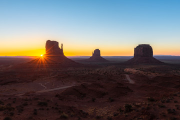 East and West Mitten Buttes, and Merrick Butte at sunrise, Monument Valley Navajo Tribal Park on the Arizona-Utah border, USA