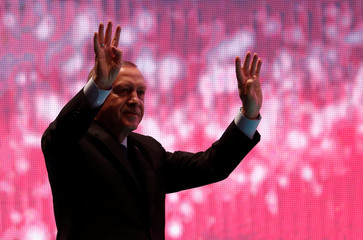 Turkish President Tayyip Erdogan greets his supporters during a ceremony marking the second anniversary of the attempted coup at the Bosphorus Bridge in Istanbul