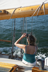 Woman Taking Photos on Old Wooden Schooner Sailboat