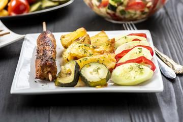 kebab on sticks served with vegetables