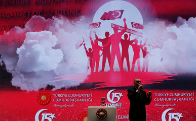 Turkish President Tayyip Erdogan addresses his supporters during a ceremony marking the second anniversary of the attempted coup at the Bosphorus Bridge in Istanbul