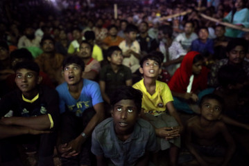 People watch the final match of 2018 FIFA World Cup between Croatia and France on a giant screen in Dhaka