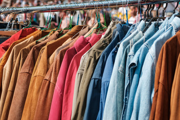 Jackets and shirts on vintage clothing market / second hand fashion flea market