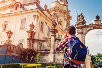 Tourist takes pictures of catholic cathedral of st. George in Lviv, Ukraine.