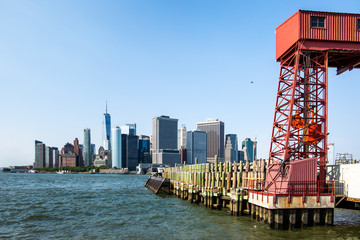 New York City / USA - JUL 14 2018: Governors Island entrance view from ferry on a clear afternoon