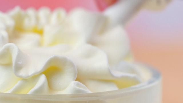 Swirls of whipped cream, macro closeup preparation for cake decorating.