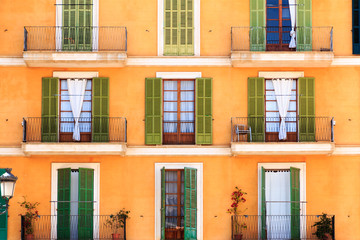 Doors and balconies on urban apartment building, Florence, Italy