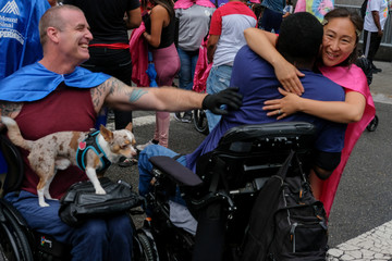 Henry greets his friends at the 2018 Disability Pride Parade in New York