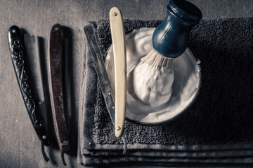 Old tools for shave with grey soap, razor and brush