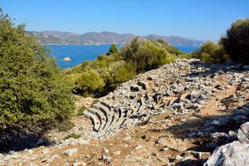Ruins of amphitheatre in Amos ancient site near Marmaris resort town in Turkey.