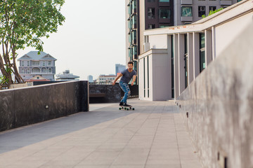Young man riding skateboard on the street.
