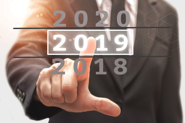 Businessman pointing business calendar happy new year 2019.