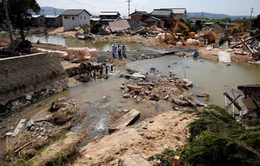 Submerged and destroyed houses are seen the site where river banks were broken along Suemasa river in Mabi town in Kurashiki
