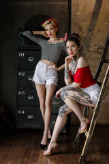 Beautiful girls dressed at pin-up style