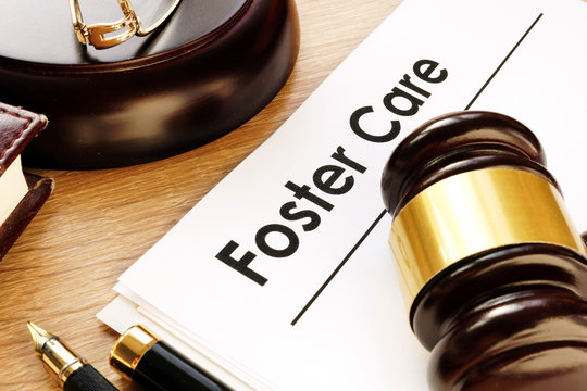 Foster care. Documents and gavel on a desk.