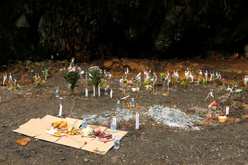 "Offerings are place during the funeral a former Thai navy diver, Samarn Kunan, who died during the rescue mission for the 12 boys of the ""Wild Boars"" soccer team and their coach, near the Tham Luang cave complex, in the northern province of Chiang Rai"