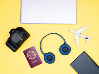 Flatlay on yellow background of blogger photographer travel kit. Top view