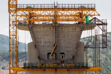 Workers are seen at the bridge construction site of the Bar-Boljare highway in Bioce