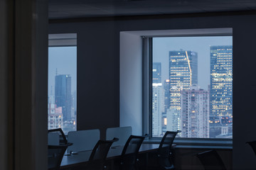 empty office and windows by night