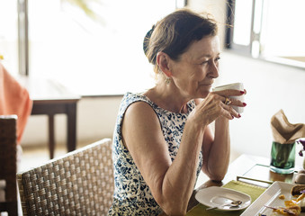 Senior woman drinking a cup of coffee