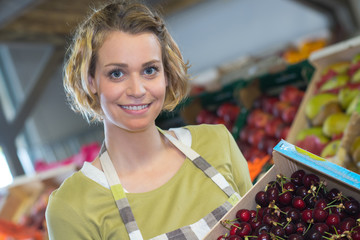 woman selling cherries