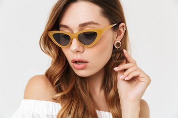 Portrait of modern fashion woman 20s wearing trendy sunglasses and earring, isolated over white background