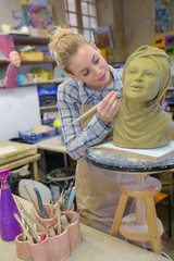Female artist working on sculpture