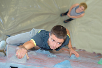 Man on indoor climbing wall